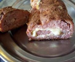 Rollo de carne relleno de queso y jamon