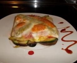 Milhojas de verdura con jamón ibérico y queso provolone