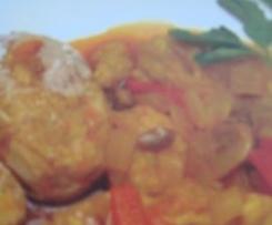 Atún en salsa de cebolla y papas arrugadas