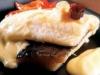 Bacalao confitado con pimientos rojos y emulsión de pil-pil