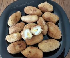 Huevos En Bechamel