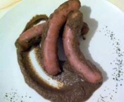 Salchichas de cerdo con salsa de champiñón
